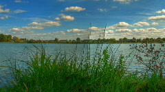 Clouds over lake hdr motion time lapse Stock Footage