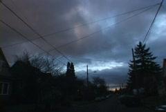 Storm Over Urban Neighborhood Time Lapse Stock Footage