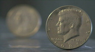 Stock Video Footage of Half Dollar & Quater Dollar Rack Focus