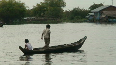 Kids in boat, Cambodia Stock Footage