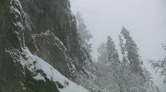 Snowy cliff face. - stock footage