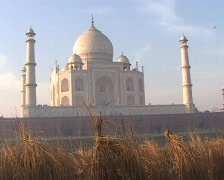 Farmer with mattock with Taj Mahal background Stock Footage
