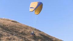 Tandem paraglider liftoff Stock Footage