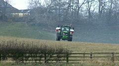 Spraying fertiliser pellets 6 - front view Stock Footage