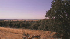 Long Zoom In Valley to Power Lines Stock Footage