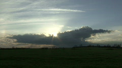 Sun emerges from behind storm cloud Stock Footage