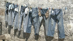 Jeans pants drying at sun Stock Footage