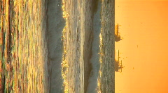 Vertical view of oil tankers at sunset Stock Footage