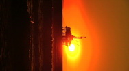 Vertical view of oil platforms at sunset Stock Footage