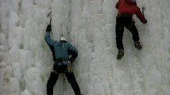 Two men ice climbing Stock Footage
