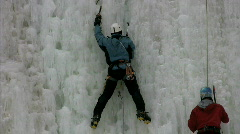 Men ice climbing together Stock Footage