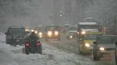 Snowstorm traffic with atv. - stock footage