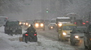 Stock Video Footage of Snowstorm traffic with atv.