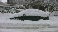 Stock Video Footage of Snow covered car.