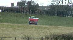 Spraying fertiliser pellets 5 - back view Stock Footage