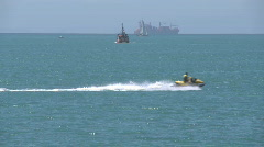jet ski crosses in front of other boats - stock footage
