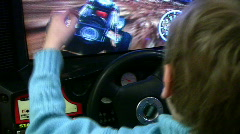 Boy drives on play machine - stock footage