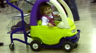 Stock Video Footage of Little girl in moving shopping cart car