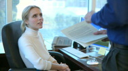 Stock Video Footage of Professional Female Speaks with a Co-worker (1 of 12)