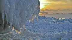 Sunset time-lapse over shoreline ice formations. Stock Footage