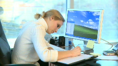 Professional Female Working at Her Desk (8 of 15) Stock Footage