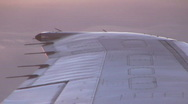 Stock Video Footage of Airliner wing at sunset