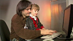 Father and daughter work with PC Stock Footage