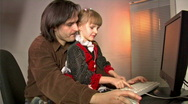 Stock Video Footage of father and daughter work with PC