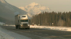 Truck on mountain highway in winter 3 Stock Footage
