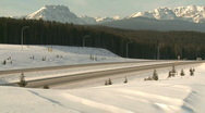 Truck on mountain highway in winter 1 Stock Footage