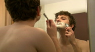 Stock Video Footage of Man Shaving in front of Mirror