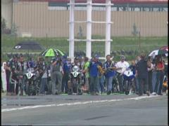 Motorsports, superbike at far end of track waiting Stock Footage