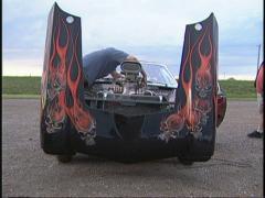Motorsports, NHRA drag racing,  black vega pro Stock Footage