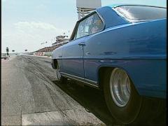 Motorsports, NHRA Darg racing, street ET launch blue nova Stock Footage