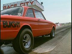 Motorsports, NHRA drag racing,  burnout red ford Stock Footage