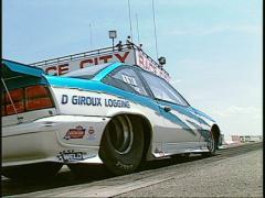 Motorsports, NHRA drag racing, burnout, superpro ground angle Stock Footage