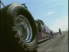Motorsports, NHRA drag racing, super-comp dragster launch Stock Footage