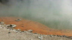 Steam from Colorful Orange Hot Springs Stock Footage