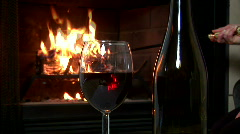 Woman stoking fire wine Stock Footage