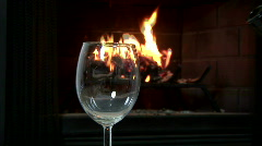 Dolly pouring wine fireplace Stock Footage