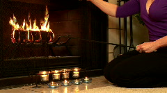 Woman stoking fireplace Stock Footage