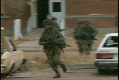 Military, soldiers running with weapons, urban fighting Stock Footage