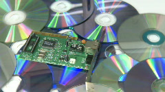 Circuit board over CD rack focus Stock Footage