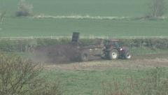 Muck spreader moves left to right - stock footage