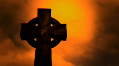 Timelapse clouds flowing past a cross in a cemetery Stock Footage