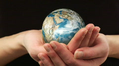 Woman holding a rotating Globe - stock footage