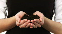 Woman Holding a plant in her hand Stock Footage