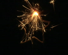 Star shaped sparkler buring Stock Footage