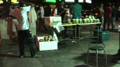 Coconut seller in Little India, Singapore Stock Footage