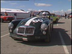Motorsports, GT race, classic MGs in the pits Stock Footage